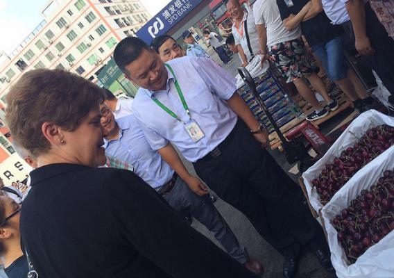 Deputy Secretary Harden examines Pacific Northwest cherries on sale at the Jiangnan Fruit and Vegetable Wholesale Market in Guangzhou.