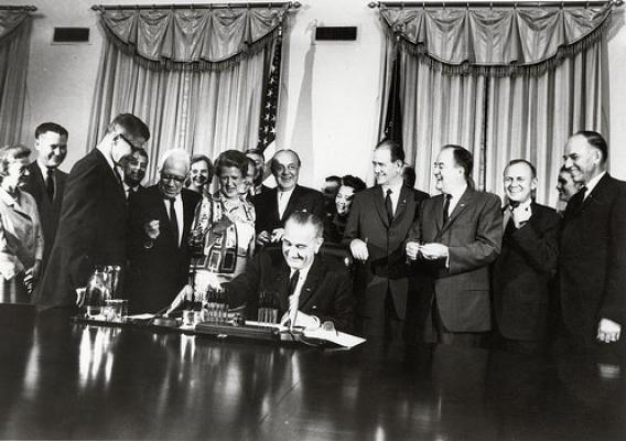 President Johnson signing the Food Stamp Act of 1964.
