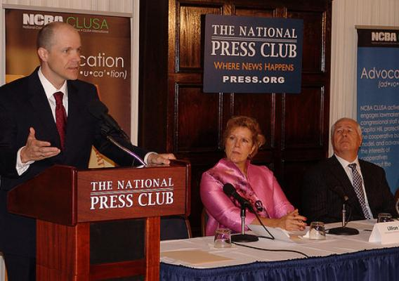 Doug O'Brien, Acting Under Secretary for USDA Rural Development addresses attendees at a National Co-op Month forum at the National Press Club in Washington, D.C. Lillian Salerno, Administrator for Rural Business & Cooperatives Programs and Charles Snyder, President of National Cooperative Bank are on the right.