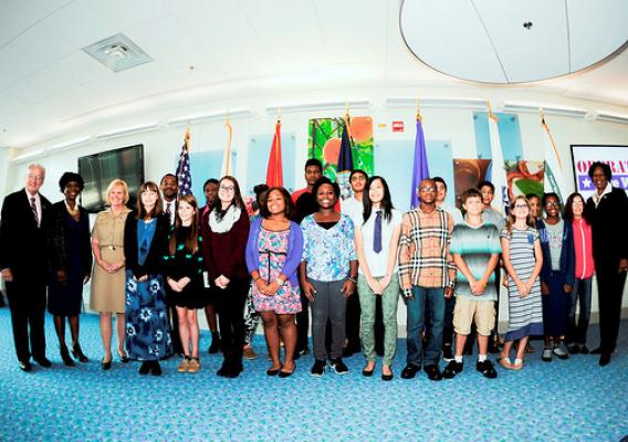 Concannon (far left) with students from Walt Whitman Middle School at Fort Belvoir Community Hospital, Va., Sept. 18, 2014.