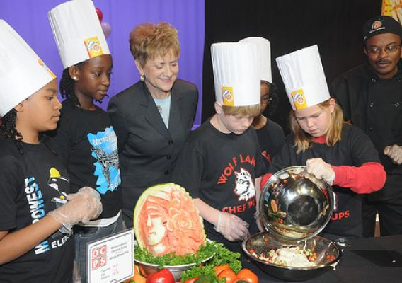 Dr. Janey Thornton, USDA Deputy Under Secretary for the Food, Nutrition and Consumer Services (center) watches as Metrowest Elementary School and Wolf Lake Elementary School student chefs cook their recipes during the Chefs Move to Schools event, Orlando, Fla. (USDA photo by Debbie Smoot)
