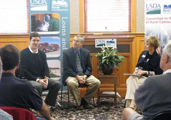 Noah Campbell, vice president of community relations for Utopian Wireless; Fred Witzig, co-coordinator of Monmouth College's Midwest Matters initiative; and Colleen Callahan, Illinois state director of USDA Rural Development discuss the benefits of broadband access for rural communities at a public forum in Monmouth, Ill.