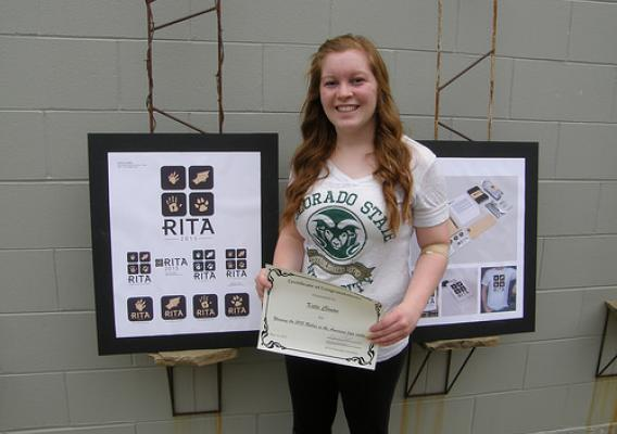 Colorado State University graphics design student Katie Clonan with her winning logo