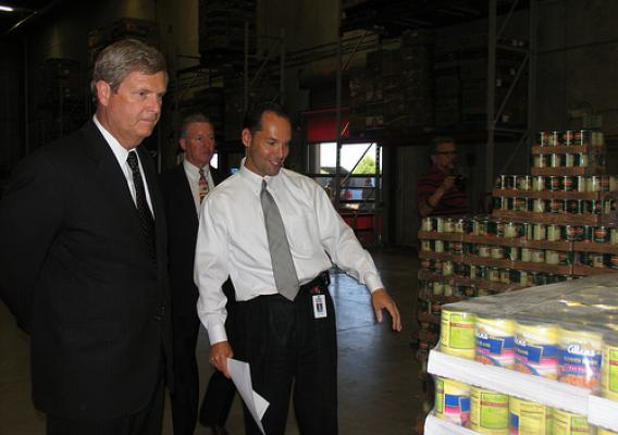 Secretary Vilsack surveys product donated to the San Antonio Food Bank with USDA FNS Southwest Regional Administrator Bill Ludwig and San Antonio Food Bank Executive Director Eric Cooper.