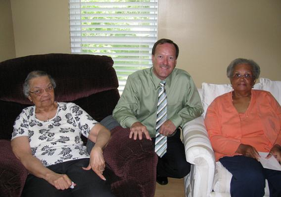 USDA Rural Development State Director Howard Henderson celebrating homeownership month with Elizabeth (left) and her daughter Doris Jones (right) in their new home.