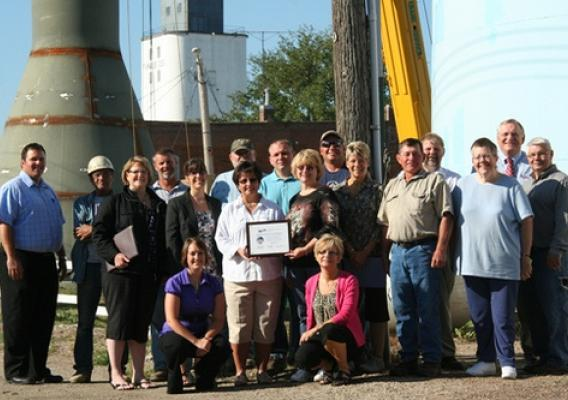 Community leaders from the Town of Ipswitch, South Dakota celebrate the construction of a new water tower.