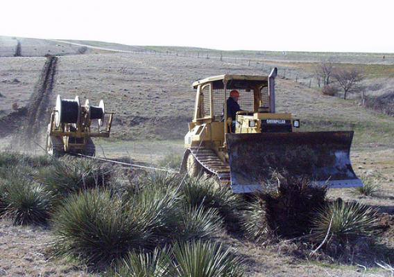 Plowing fiber optic cable in Northwest Kansas. (Photo courtesy of Rural Telephone)
