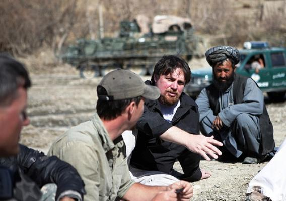 EIAO Gary Tietz talks with farmers in Afghanistan while on assignment working with President Obama's Civilian Surge in Afghanistan.