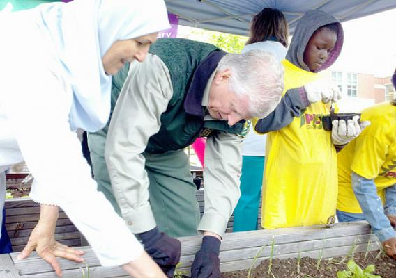 U.S. Forest Service Chief Tom Tidwell  participates in Earth Day festivities at Barnard Elementary School  that included building raised bed gardens, planting vegetables and showcasing the school's outdoor classroom in Washington, D.C.