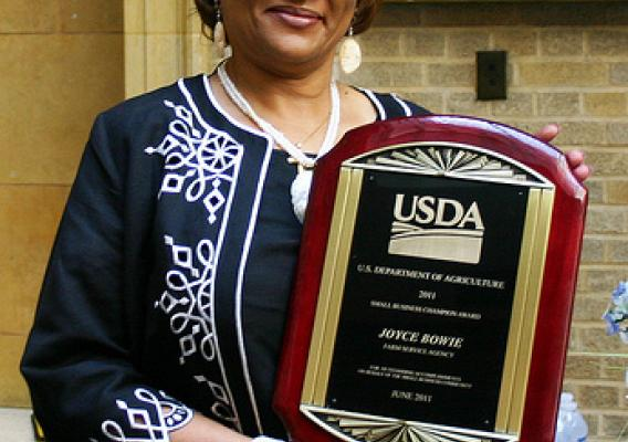 Director of Contracting Activity Designee Joyce Bowie with her award.