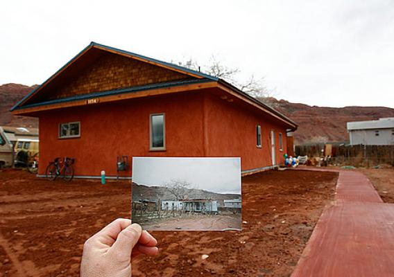 The finished home with a photo of the trailer it replaced (foreground)