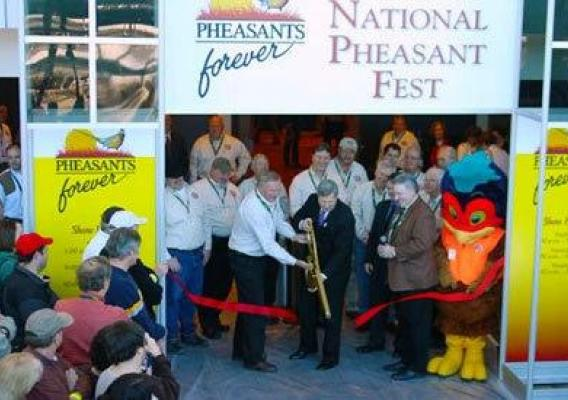 Agriculture Secretary Tom Vilsack traveled to Nebraska last week. He addressed students and Ag leaders.  Here the Secretary cuts ribbon at open of 2011 Pheasant Fest in Omaha.