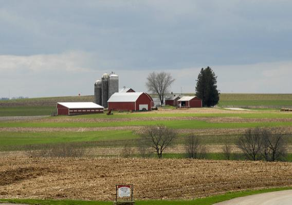 A family farm sits on small knoll in La Crosse, Wisconsin.