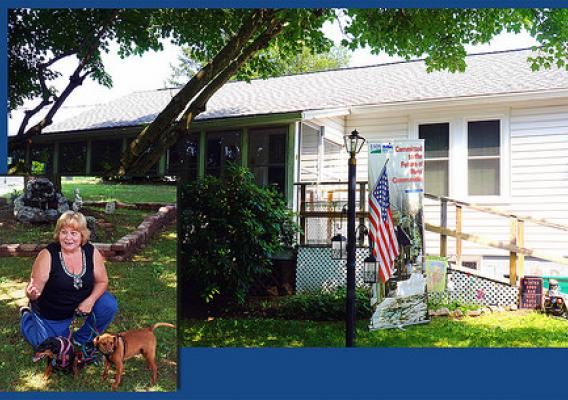 Collette Brandt and her miniature pinschers enjoy their new home, particularly the large yard and beautiful tree. Collette walks the dogs through her new neighborhood as part of her therapy.