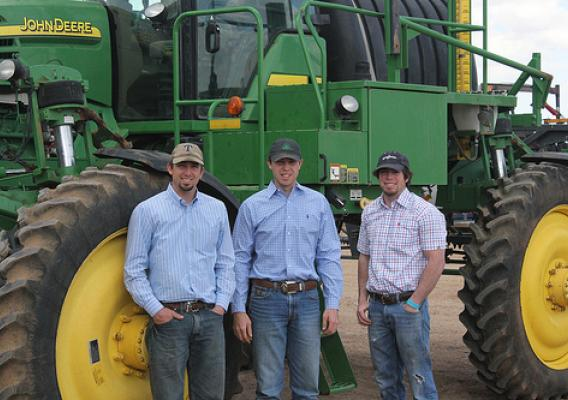 The Gruhlkey brothers – Brittan, 24, Braden 25, and Cameron 20 – worked with NRCS through the Ogallala Aquifer Initiative to adopt better equipment and techniques to manage their water use. USDA photo.