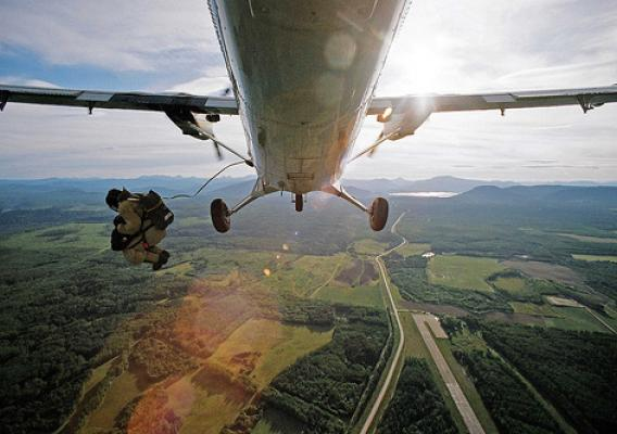 A smokejumper exits a plane. (US Forest Service photo)
