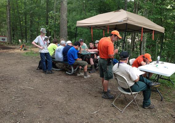 Boy Scouts work on pulp and paper merit badge at the Forest Service exhibit. (U.S. Forest Service photo)