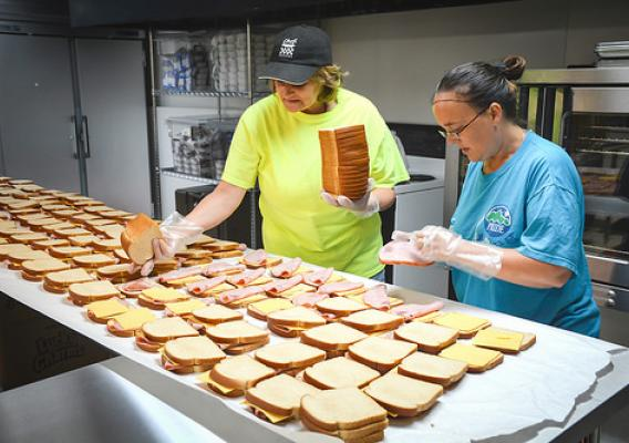 KCEOC staff, Latisha Smith (left) and Daphne Karr, preparing up to 1,800 sack lunches each day