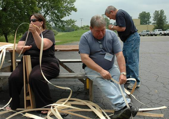 Kelly Church, Grand Traverse Bay Band of Ottawa and Chippewa; Richard Silliboy, Aroostook Band of Micmacs; and Butch Jacobs, Passamaquoddy, evaluate the quality, strength and condition of green ash splints pounded from experimental black ash logs.
