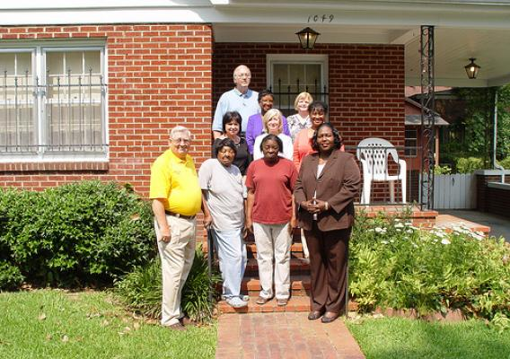 (Front row, from right to left) State Director George, Ms. Spearman, Ms. Monger, and Grenada Mayor Collins stand in front of Ms. Monger's new home in Grenada.