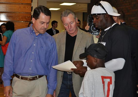 RA Ludwig, Texas Department of Agriculture Todd Staples, Deion Sanders and Former NFL Athlete/Hall of Famer review activities that are planned for the children at Sanders' youth camp.