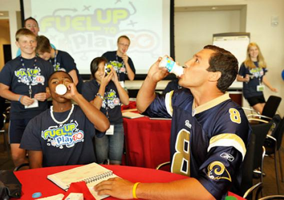 St. Louis Rams quarterback Sam Bradford challenges Fuel Up to Play 60 participants to a milk drinking competition during the Student Ambassador Summit in Washington, D.C. (Photo Courtesy of fueluptoplay60.com)