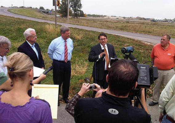 Iowa Congressman Leonard Boswell, U.S. Agriculture Secretary Vilsack and President of the Iowa State Building and Construction Trades Council, Bill Gerhard discuss efforts to strengthen the Iowa economy at the Des Moines Morningstar Bridge.