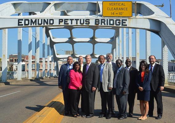 Secretary Tom Vilsack, Congresswoman Terri Sewell and Selma Mayor George Evans along with USDA State Directors and local officials at the Edmund Pettus Bridge in Selma, Ala