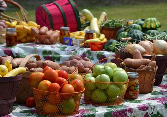 Baskets of fruits and vegetables on tables