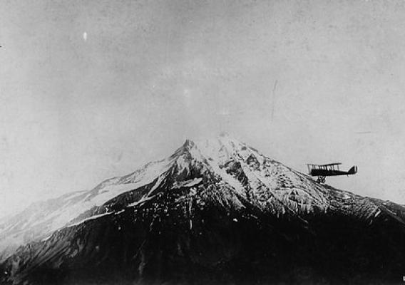 Airplane fire patrol circling Mt. Jefferson in the Cascade Range. (Credit U.S. Army Air Service 1920.)