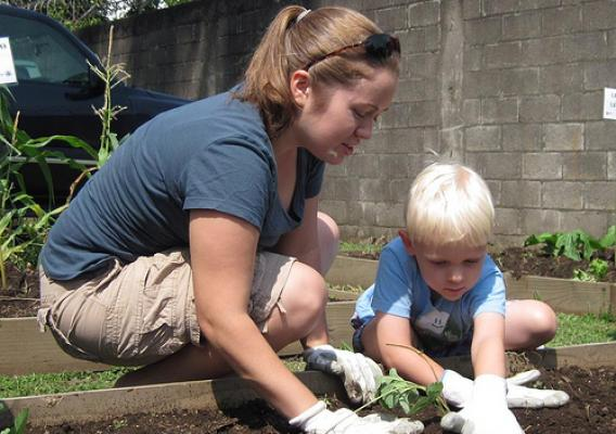 Sara Roy and her son, Malachi, enjoy working together in the garden.