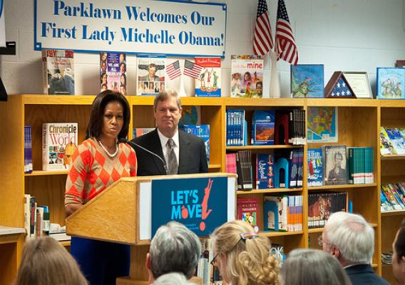 "First Lady Michelle Obama joined Agriculture Secretary Tom Vilsack at Parklawn Elementary School to speak with faculty and parents about the United States Department of Agriculture's new and improved nutrition standards for school lunches. An important accomplishment of the Healthy, Hunger-Free Kids Act that President Obama signed into law last year. Also, in In February 2010, First Lady Michelle Obama introduced ""Let's Move"" incorporating the HealthierUS School Challenge into her campaign to promote a heal"