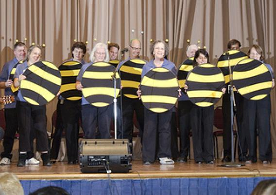 "Class of 2010 graduates sing a sweet tune welcoming our ""new-bees"" as Executive Master Gardeners"