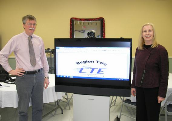 School of Applied Technology Director Michael Howard and USDA Rural Development State Director Virginia Manuel stand next to the distance learning technology that will expand adult learning opportunities thanks to $1.48 million in Distance Learning and Telemedicine Grant funds