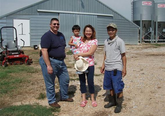 NRCS Supervisory District Conservationist Joe Addy worked with Diem Nguyen, her husband, John Pham, and daughter, Angela, to make their Newton, Miss. chicken farm more environmental friendly.