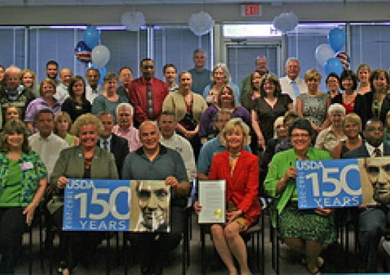 Indiana Lt. Governor Becky Skillman (Center front row) joins Indiana State Office Staff members from Natural Resources Conservation Service, Farm Service Agency, Rural Development, and Risk Management Agency in celebrating USDA's 150th birthday.