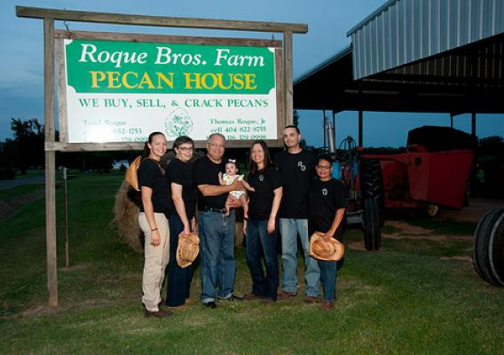 Thomas Roque, Jr., works an 800-acre farm that has been in his family for 95 years. Thomas Roque's family (l to r) Tiffany Roque, sister; Kathie Roque, mother; Thomas Roque, Sr., father; Sydney Roque, daughter; Anna Darensbourg Roque, wife; Thomas Roque, Jr.; Theresa Roque, aunt.