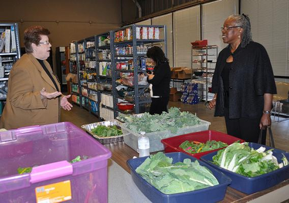 Camilla Zimbal, social services director for Metrocrest Social Services, explains how they get fresh produce for their clients to Audrey Rowe, administrator for Food and Nutrition Service.