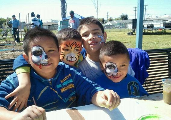 "A Kids Zone added fun with face painting and other activities during planting at the Urban Tilth Edible Forest in Richmond, Calif. Other highlights were the community barbeque and a ""make your own soda"" used to teach children how much sugar goes into their favorite beverage."