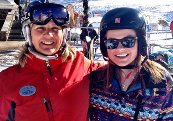 Kristin Merony and Tammy Randall-Parker, a Forest Service district ranger and a ski instructor at Telluride Mountain Resort, after Kristin's first solo run down the mountain after a day of ski lessons. (U.S. Forest Service)