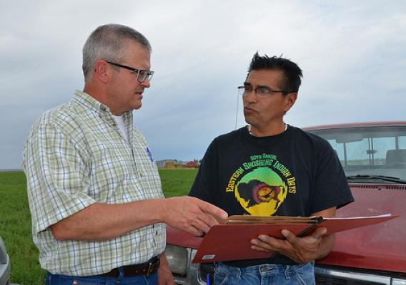 Chuck Petersen, NRCS rangeland management specialist (left), and Reggie Premo, Shoshone-Paiute Tribal member, discuss future conservation plans on Premo's ranch located on the Duck Valley Reservation in Nevada. USDA photo.