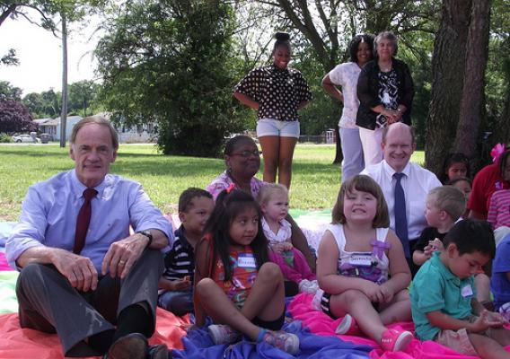 United States Senators Tom Carper (left)  and Chris Coons (right) with children attending Primeros Pasos (First Steps).  The children will move to a larger facility with funding assistance from USDA. USDA photo.