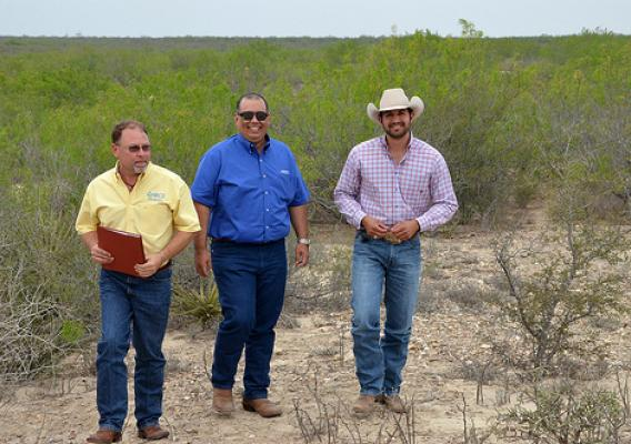 From left: Flavio Garza, NRCS district conservationist, Jorge Espinoza, and Henry Gonzalez, NRCS rangeland management specialist, visit on Espinoza's ranch about forage establishment. USDA Photo.