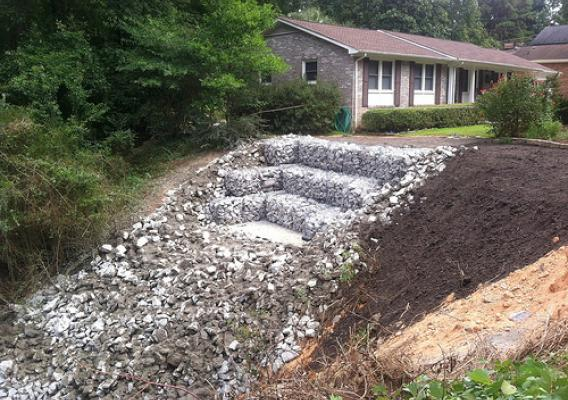 Through the Emergency Watershed Protection Program, NRCS helped tame a major erosion problem and save a West Columbia, S.C. home. NRCS photo.