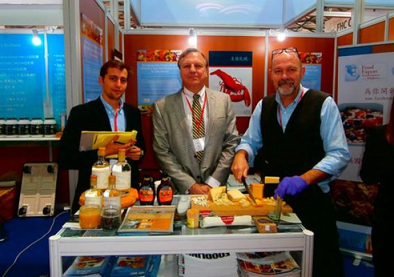 Alex Weiss from Caledonia Spirits, Arnold Coombs from Bascom Family Farms, and Jeremy Stephenson from the Vermont Cheese Council, attend the Food and Hotel China Show in Shanghai to exhibit their agricultural products. The small businesses attended the trade show with the help of one of the State and Regional Trade Groups – coalitions of state departments of agriculture – that use USDA market development program funds to provide support for about 30,000 companies annually. (Courtesy Photo)