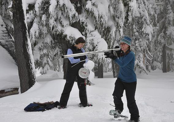 NRCS Oregon hydrologists Melissa Webb and Julie Koeberle measure snow on Mount Hood, Ore. (NRCS photo)