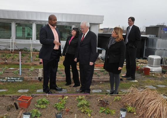 Bread for the City CEO George Jones (far left) shows the organization's rooftop garden to AMS Administrator Anne Alonzo (right with black coat and grey shirt), AMS Associate Administrator Rex Barnes (far right), Food Nutrition and Consumer Services Under Secretary Kevin Concannon (middle), and FNS Associate Administrator for the Supplemental Nutrition Assistance Program Jessica Shahin (middle left).