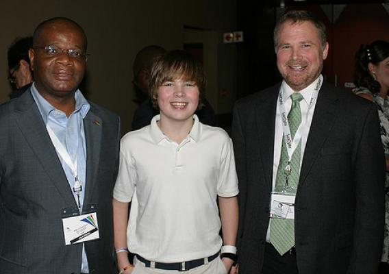 Mozambique Minister of Science and Technology Louis Pelembe (left) meets with National Soybean Research Laboratory  Director Craig Gundersen and his son, Van, during the World Soybean Research Conference earlier this year. Minister Pelembe participated in the Foreign Agricultural Service Cochran Fellowship Program and has used his training to help address critical food security and develop agricultural policy in Mozambique. (Courtesy photo)