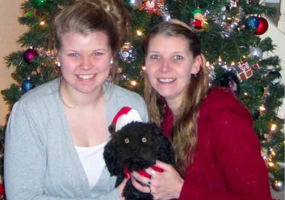 Misty Allen (right), her daughter Deanna and puppy Odysseus are ready for family and friends to share the holidays in their new home. (USDA photo)