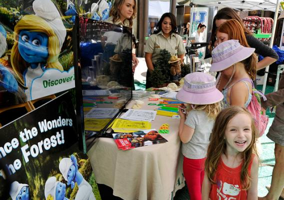 Young Smurf fans visit the Forest Service's booth during a community outreach event promoting the Discover the Forest campaign. (U.S. Forest Service photo)